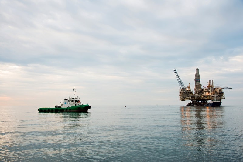 Oil rig being towed into the sea