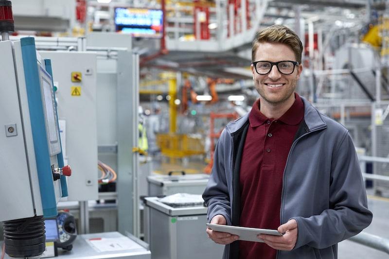 Sales engineer in an industrial factory